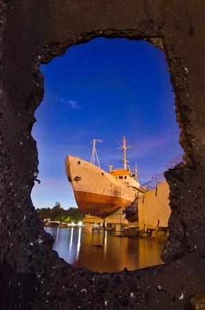 Ship in night harbor - graving-dock