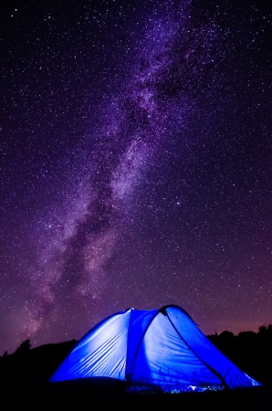 Tent against the Milky Way and starry sky  The popularity of natural outdoor recreation and travel concept