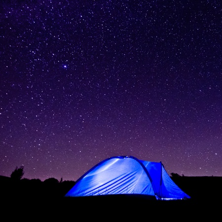 camping tent: Tent against the Milky Way and starry sky  The popularity of natural outdoor recreation and travel concept