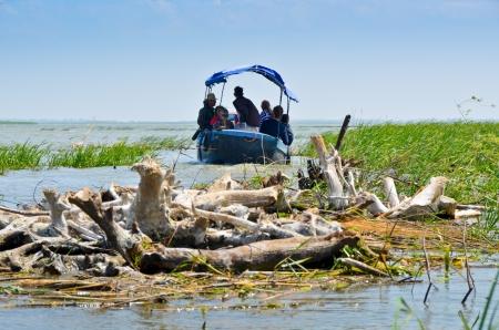 danube delta: VILKOVO, UKRAINE - May 19  Danube delta  Undefined people floating in a boat  Vilkovo-city on the water at the delta of Danube - the European Union