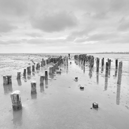 Enjoy the silence - alone man on unusual cloudy  landscape photo