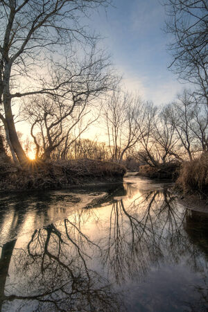 Autumn sunset on the fall icy river Stock Photo