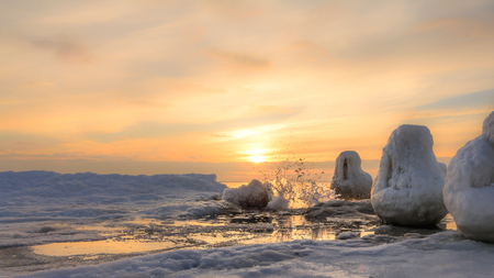 Frozen pier and ocean ice colorfull sunrise
