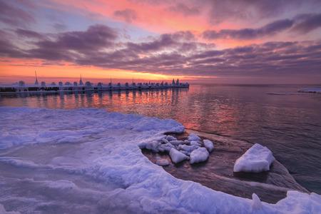 Wave on frozen ocean ice sunrise light