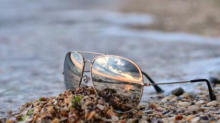 Traveller dreams concept - ocean reflection on sunglasses