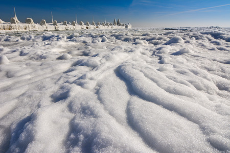 Frozen ice ocean coast and blue sky - polar winter pier Stock Photo