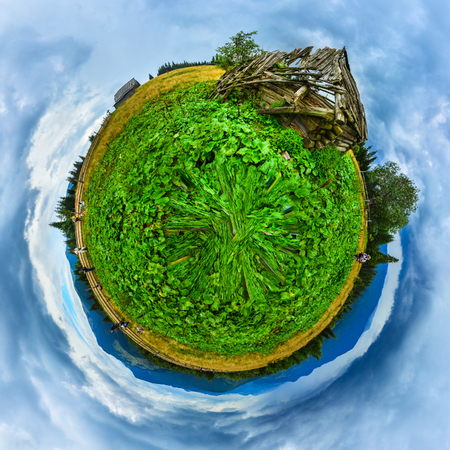 Green mountains field with old wooden house ruins planet panorama