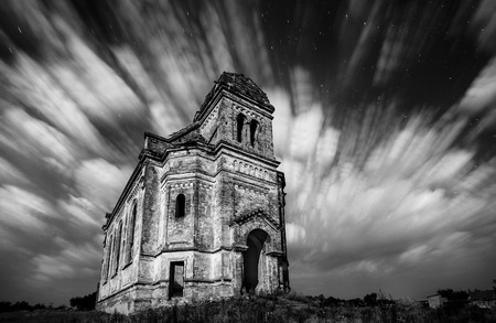 The old church flying in stormy clouds background