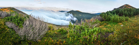 Above the clouds mountain panorama background Stock Photo