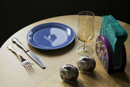 homey: cutlery for a dinner private on a round table