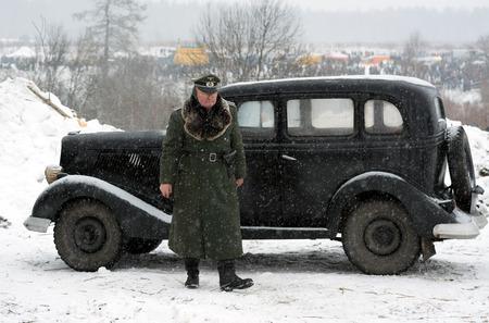 wehrmacht: Nazi general stands near retro black car