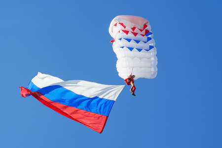 peterburg: ST. PETERBURG May September 2015: Parachutist in the sky with Russian flag. Victory day parade Editorial