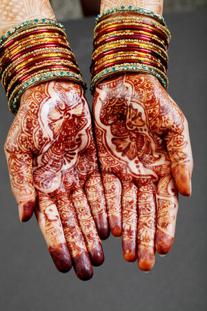 Traditional Indian woman hands with henna  photo