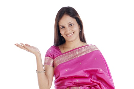 traditonal: Excited smiling young traditonal Indian woman against white background