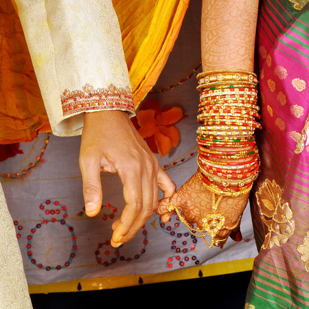 Wedding hands on Indian couple