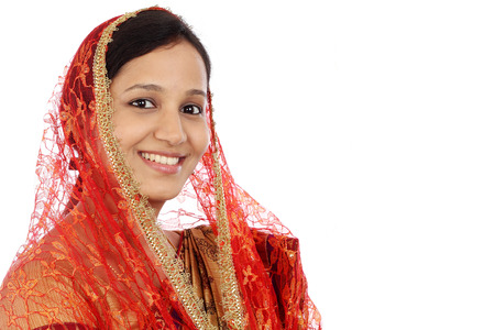Portrait of young muslim woman against white background photo