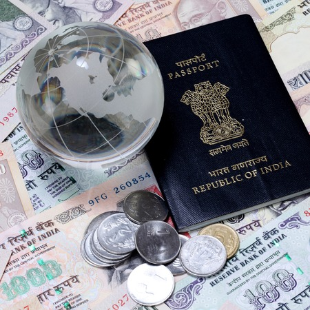 indian currency: Moneda de la India con el pasaporte y el globo de cristal Foto de archivo
