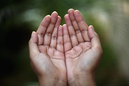 Closeup view of praying hands photo