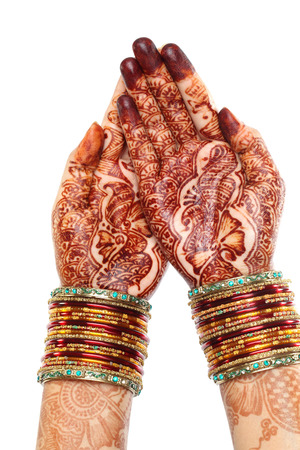 bangles hand: Woman hands with henna design white Stock Photo