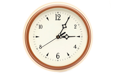 Brown color wall clock isolated on white background photo