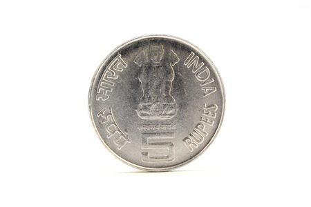 Indian five rupee coin on white background photo