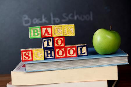 ABC blocks and apple against black board