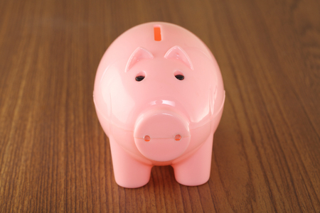 Front view of piggy bank isolated on a table photo