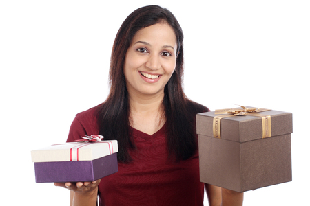 Happy young woman with gift boxes against white photo
