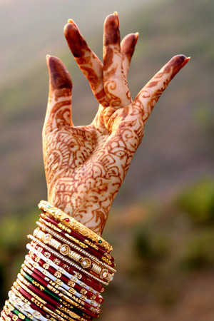 beautification: Beautiful hands of an India Bride with colorful bangles