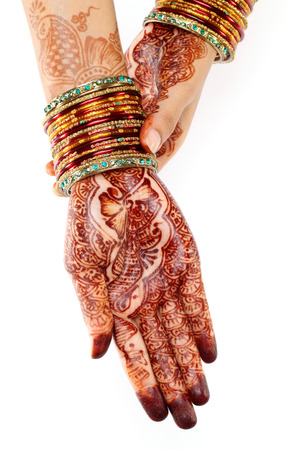Woman hands with henna design on white photo