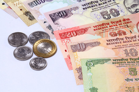 Closeup of Indian currency notes and coins photo