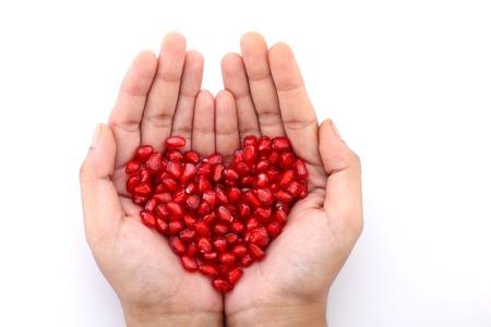 silhouette coeur: Les graines de grenade en forme de coeur