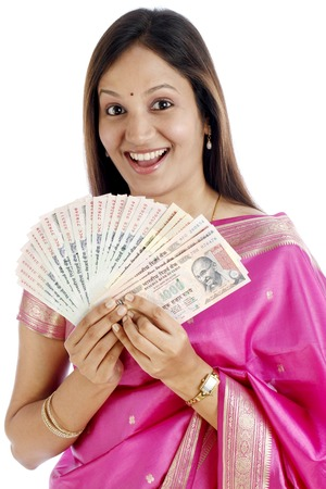 Smiling young Indian traditional woman holding Indian rupee notes photo