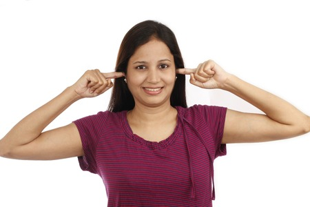 Young woman  covering ears with fingers - Noise and stress concept photo