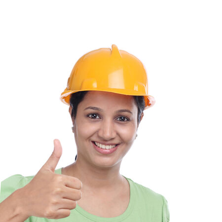 Successful young construction engineer with thumbs up gesture photo