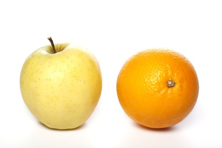 antipode: Yellow apple and orange isolated on white background Stock Photo