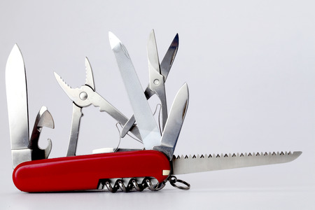 All purpose swiss army knife on white photo