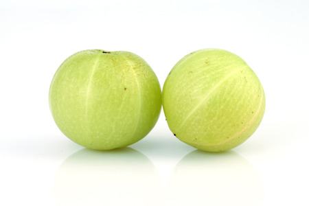 Gooseberries (amla) on white