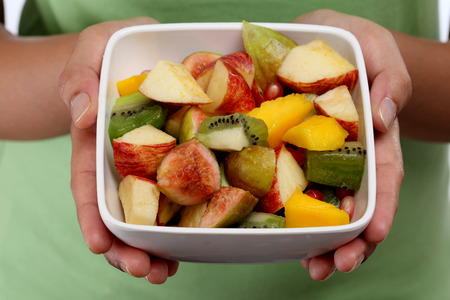 Fruit salad in the hands  photo