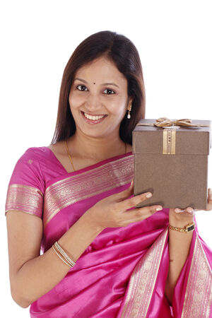 Smiling young traditional woman holding gift box photo