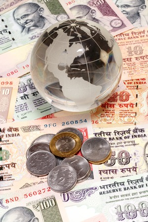 indian currency: Glass globe on Indian currency