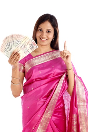 indian saree: Smiling young traditonal woman holding Indian currency  Stock Photo
