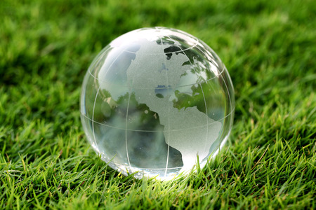 Glass globe in the grass - Environment concept photo