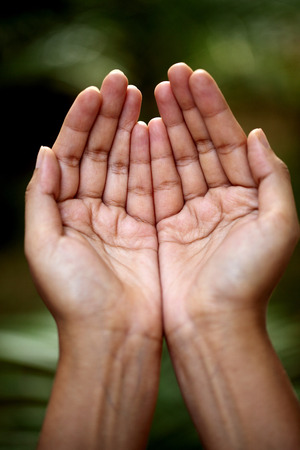 confessing: Closeup view of praying hands