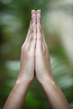 Closeup view of praying hands photo