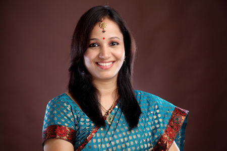 Portrait of beautiful smiling young Indian traditional woman photo