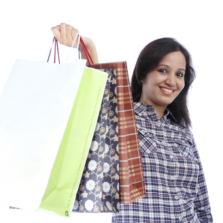 Young indian girl holding shopping bags photo