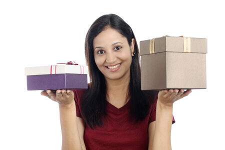 Young smiling woman with gift boxes against white background photo