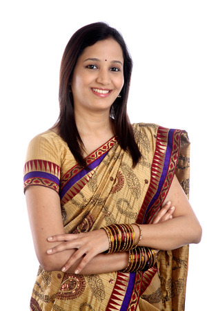 Happy young traditional woman with arms crossed photo