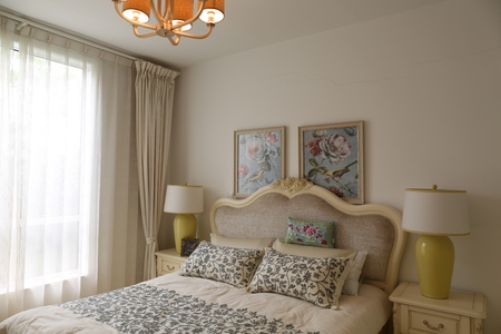 white and purple interior of bedroom